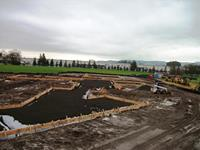 Forms have been completed, rock and sand have been placed, and Rebar is ready to be installed.